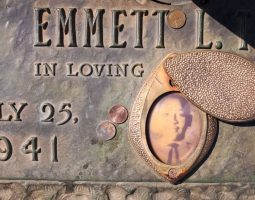 A faded photograph is attached to the headstone that marks the gravesite of Emmett Till in Burr Oak Cemetery in suburban Chicago, Illinois, on March 22. Till's brutal murder in Money, Mississippi in the summer of 1955 and his mother's decision to hold an open-casket funeral to expose the brutality of the murder is credited with igniting the modern civil rights movement. (Scott Olson/Getty Images)